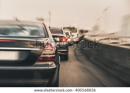 traffic jam with row of cars on expressway during rush hour , morning fog light, vintage process style - stock photo