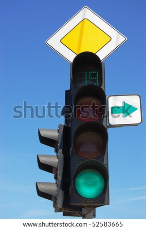 Traffic light against the blue sky
