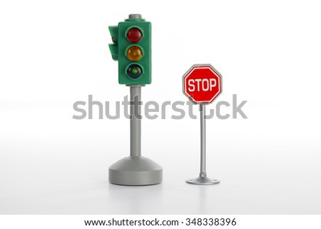 Traffic light and stop road sign on white