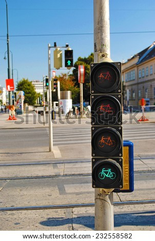 Traffic light for cyclists and pedestrians on the road - stock photo