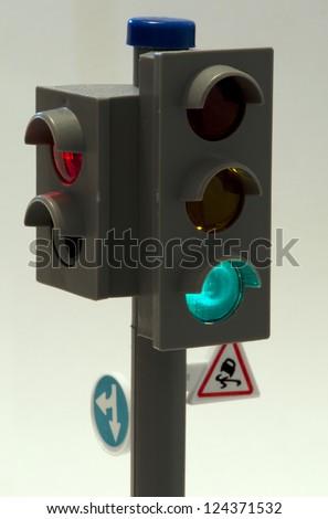 Traffic light illuminated toy. Green signal - stock photo