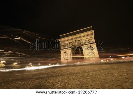 Traffic Light in Paris Night in Paris near Arc De Triomphe and Avenue Des Champs-Elysees - stock photo