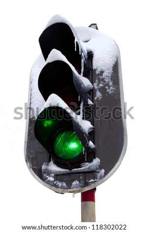 Traffic light in the snow. White background. Object.