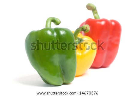 Traffic light of colored pepers on white - stock photo