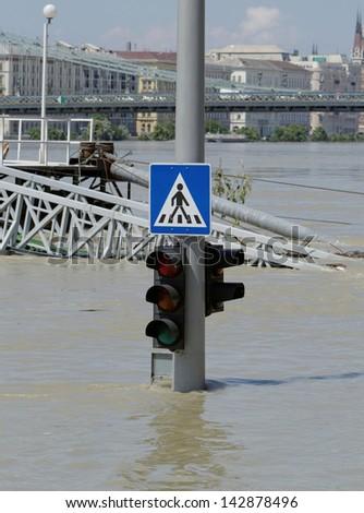 traffic light on flooding river - stock photo