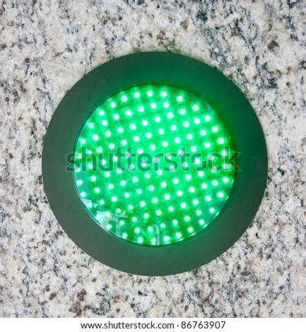 Traffic light on green - go sign - stock photo
