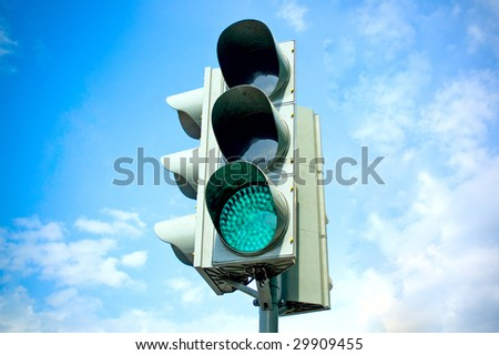 Traffic-light on sky background - stock photo