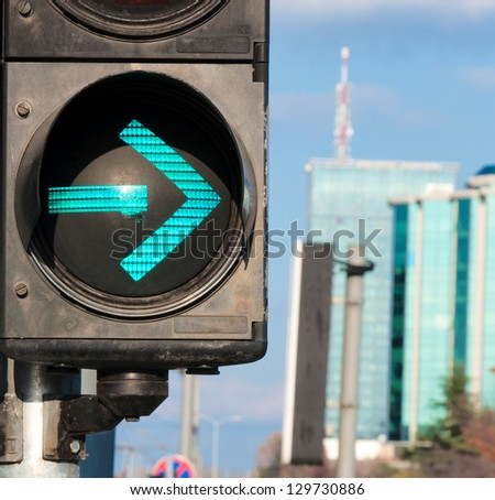 Traffic light showing the green arrow. Selective focus on the green arrow - stock photo
