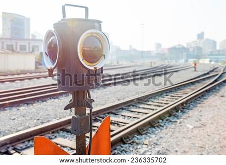 Traffic light shows blue signal on railway - stock photo