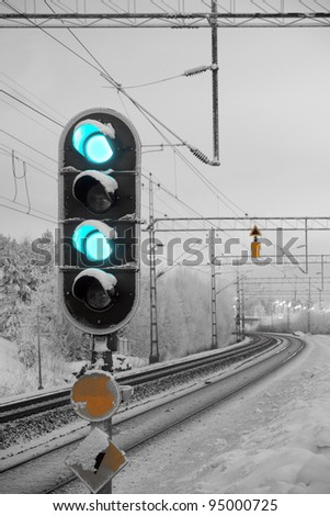 Traffic light shows green signal on railway - stock photo