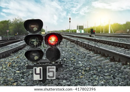 Traffic light shows red signal on railway. Prohibiting signal. Railway station.  - stock photo