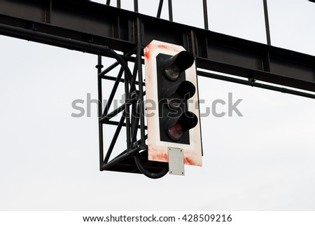 Traffic light shows red signal on railway. Red light with white sky - stock photo