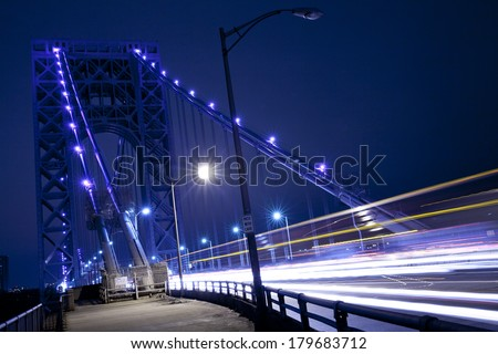 Traffic light trails at George Washington Bridge in New York City.  George Washington Bridge is a double-decked bridge that connects New York City and New Jersey. - stock photo