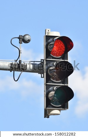 Traffic light with camera for traffic control - stock photo