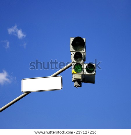 Traffic light with green sign turned on - stock photo
