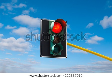 Traffic lights against the sky is lit red  - stock photo