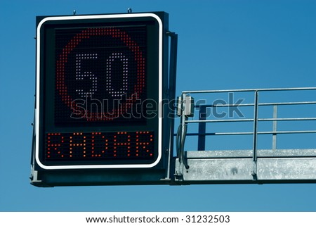 Traffic lights -  in front of blue sky - stock photo