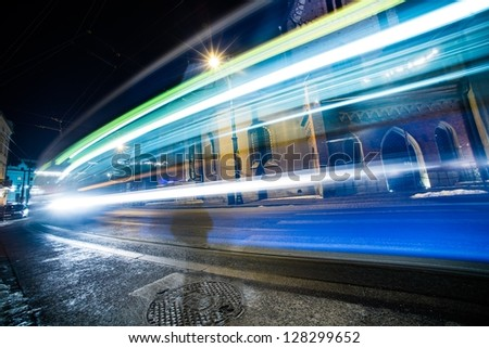 Traffic Lights in Long Time Exposure. Speeding Tramway and Cars in Cracow, Poland. Transportation Photography Collection.