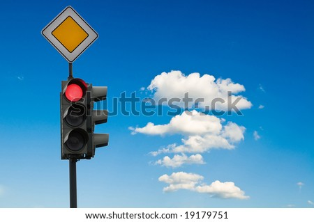 Traffic lights - on in front of blue sky