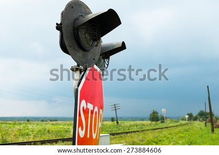 Traffic lights, stops sign and crossbuck sign at the railroad crossing in Ukraine - stock photo