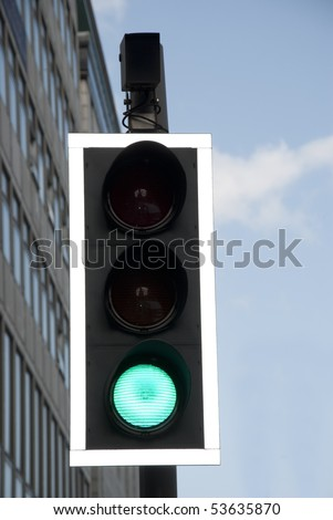 Traffic lights with green sign on street - stock photo