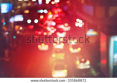 Traffic Movement in the Night City. Blurred Defocused Multi Color Lights. Toned in Vivid Colors. Abstract Background - stock photo