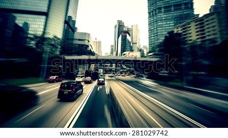 Traffic moving at speed on the road, Hong Kong - stock photo