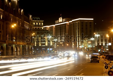 Traffic of cars in Moscow city center (Teatralny Proezd near the Building of The State Duma of the Federal Assembly of Russian Federation), Russia      - stock photo