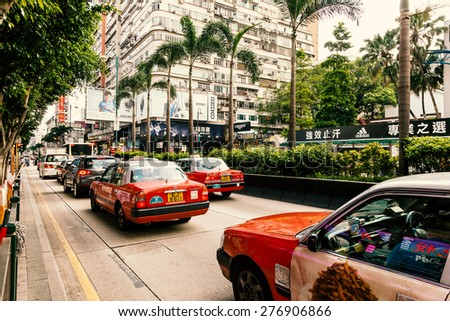 Traffic of Red Taxi on the street of Nathan Road, Hong kong, China, 20 june, 2013 - stock photo