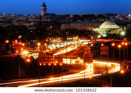 Traffic on a highway at night with a memorial in the background, Jefferson Memorial, Tidal Basin, Washington DC, USA - stock photo