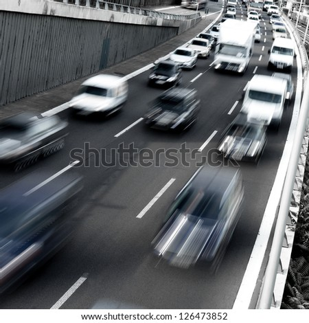 traffic on a highway in early morning - stock photo