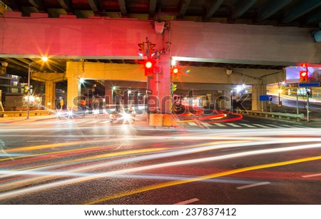 Traffic on an underpass in Toronto at night - stock photo