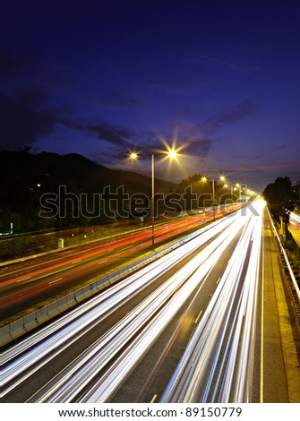 traffic on highway at night - stock photo