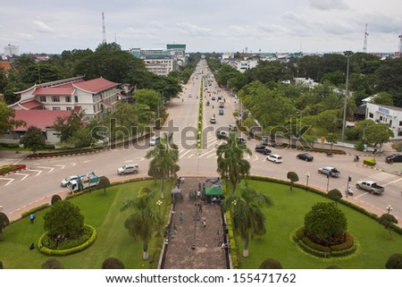Traffic on Lane Xang avenue in Vientianne, Laos. The estimated population of the city is 754,000. - stock photo