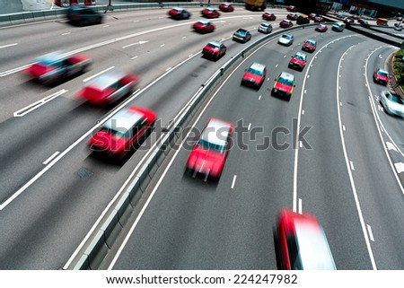Traffic on multiple lane highway with motion blur - stock photo