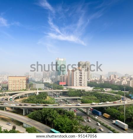 traffic on the grade separation bridge under the blue sky - stock photo
