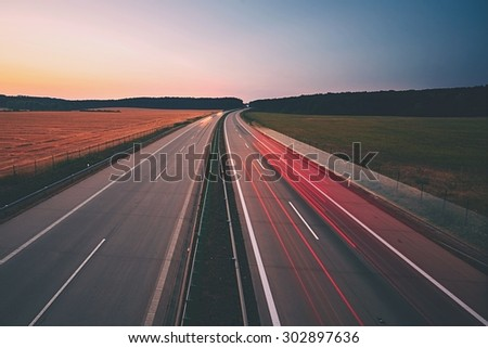 Traffic on the highway at the sunrise - stock photo