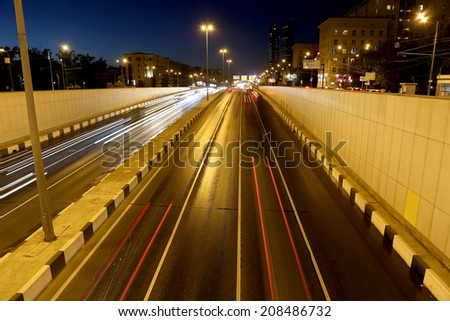 Traffic on the highway of big city (at night), Moscow, Russia