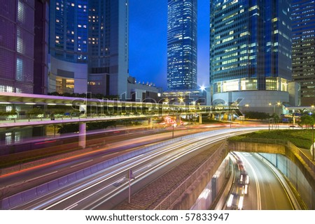 Traffic on the move at night - stock photo