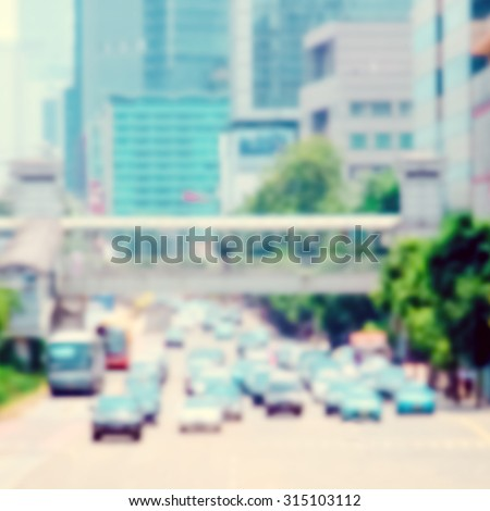 Traffic on the street in the city - stock photo