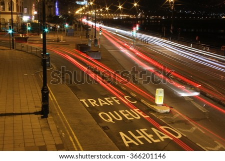 Traffic Queue Ahead car light trails - stock photo