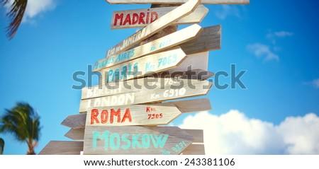 traffic road  sign including Moscow, Roma,London,Berlin,Paris,Madrid, Rio de Janeiro on blue sky background - stock photo