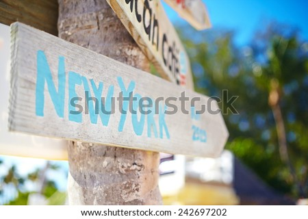traffic road  sign including of New York on green tropical  background - stock photo