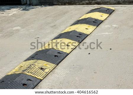Traffic safety speed bump - stock photo