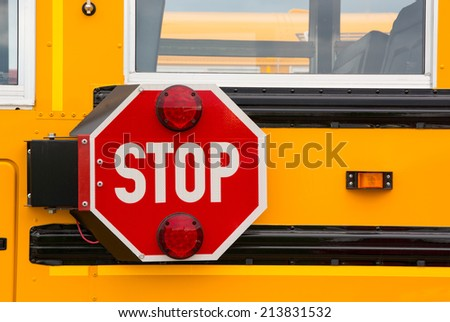 Traffic safety stop sign on a school bus - stock photo