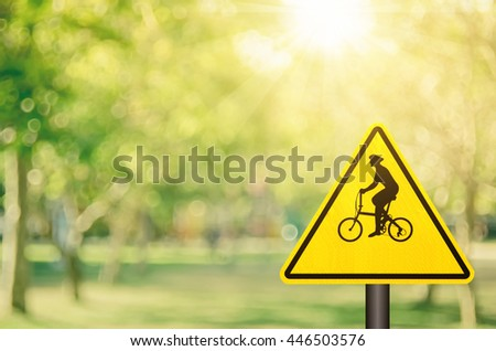 Traffic sign,bicycle sign on blur nature green park with bokeh sun light background. Retro color style.