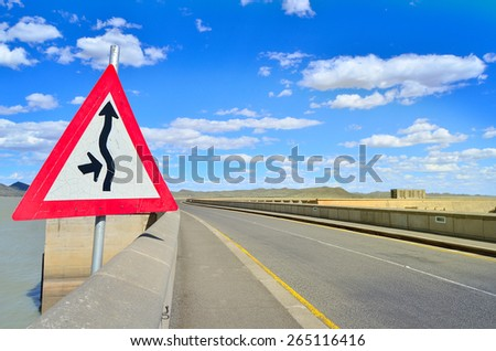 Traffic sign by the road showing direction  - stock photo