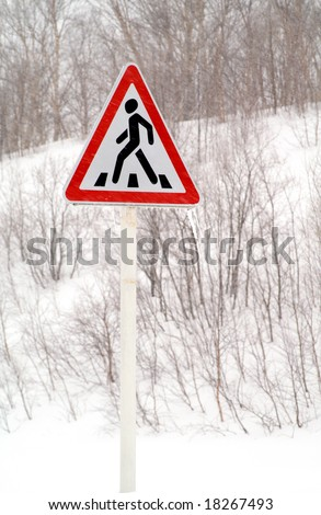 traffic sign  covered by snow, concept of bad weather