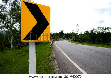 Traffic sign curve - stock photo