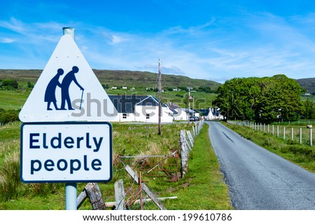 traffic sign for paying attention for elderly people at the entrance of a small Scottish village - stock photo